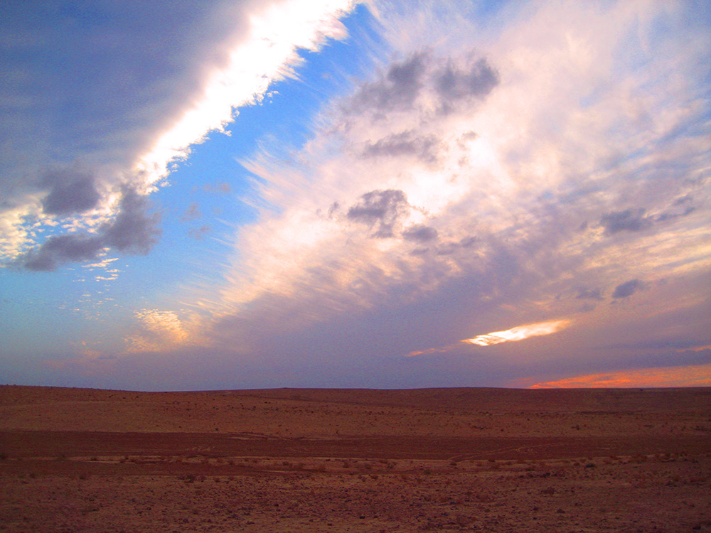 Sun-set in the desert by Qasr Bashir